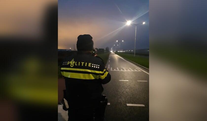 <p>De politie stond vanochtend al vroeg met een lasergun te controleren. (Foto: politie Pijnacker-Nootdorp) </p>