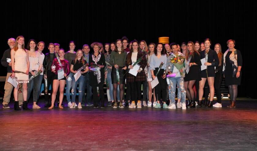 De winnaars gezamenlijk op de foto.