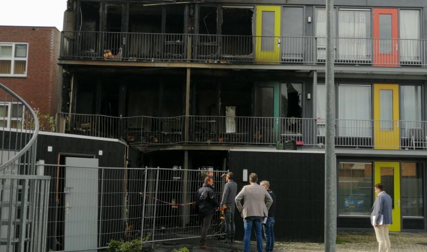 Verwoeste appartementen in de Berghemseweg.