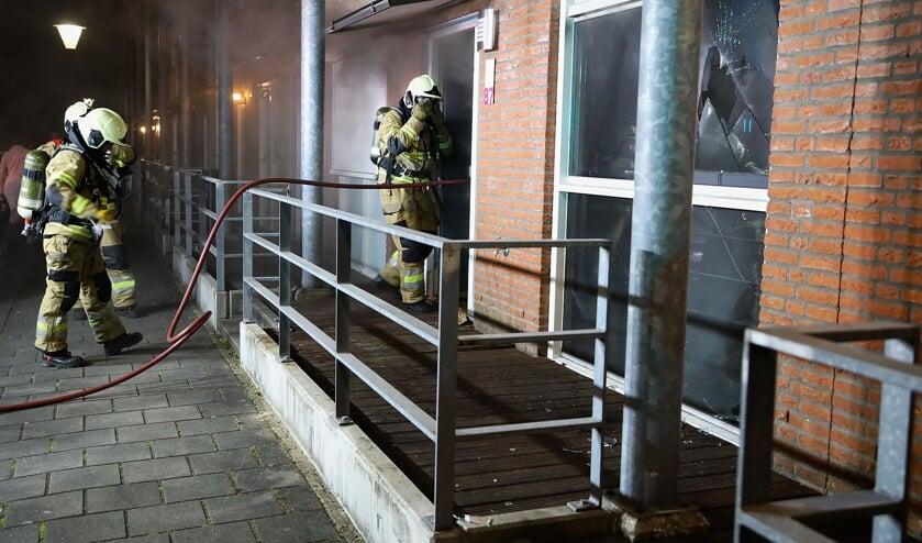 Brandweer in de Slotgracht. (Foto: Gabor Heeres, Foto Mallo)