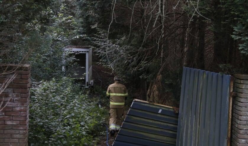 In bosje in Mill is een caravan uitgebrand.