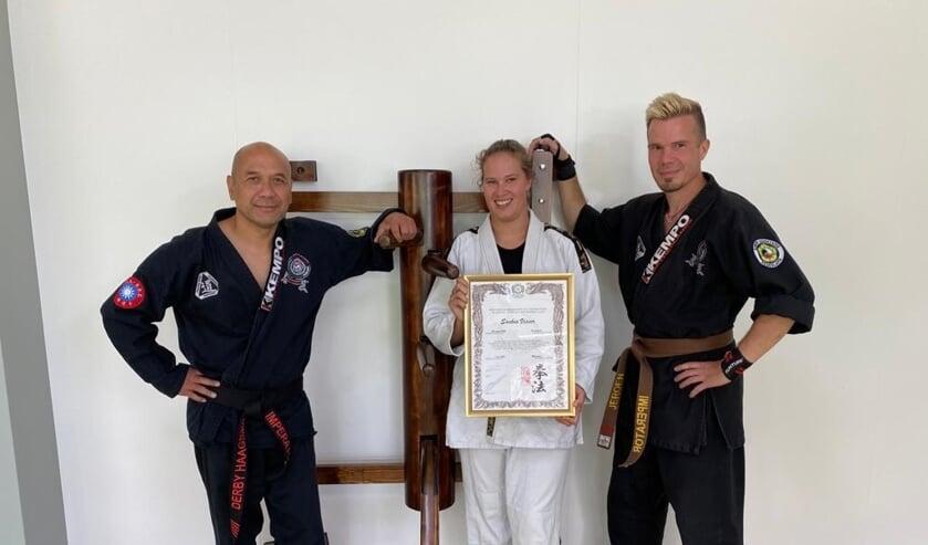 Saskia Visser en haar begeleiders.
