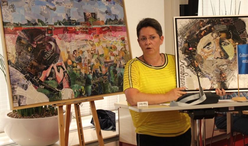 Lisette Hogewoning met achter haar één van haar collages.   Foto: Nico Kuyt.