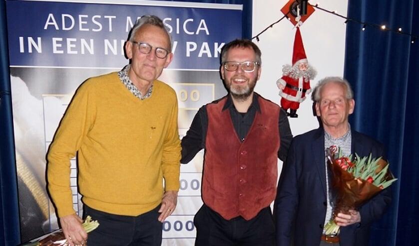 Jubilarissen Kees de Jong, Jeroen Pluimers en Hans Kaptijn.